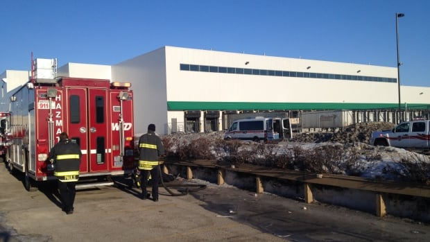 Hazmat units and firefighters at a warehouse near Inkster Boulevard and Keewatin Street in Winnipeg on Wednesday morning. The leak has been contained.