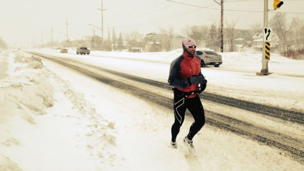 Moncton teacher Armand Doucet is running 30 kilometres a day for 30 days to encourage young people to exercise.