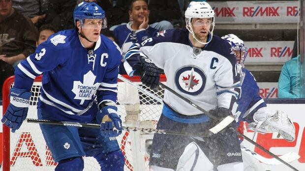 Leafs captain Dion Phaneuf, left, tracks the Winnipeg Jets' Andrew Ladd during an  NHL game on March 16, 2013 at the Air Canada Centre in Toronto.