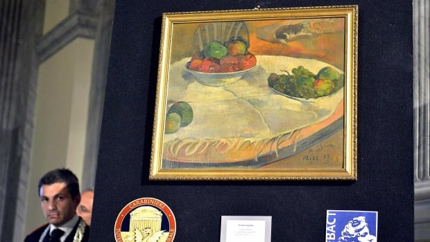 Police officials in Rome unveiled on Wednesday this Paul Gauguin still life, which was stolen from a private collection in Britain in 1970. It has hung on a kitchen wall of a retired Sicilian autoworker's home for 40 years, after he purchased it and another painting for the equivalent of about $100 dollars at a railway auction of unclaimed lost items in 1975.