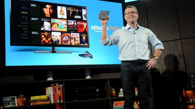 Amazon's Peter Larsen introduced Amazon Fire TV at a press conference in New York today. The device, about the size of a CD case, runs Google's Android operating system and offers Netflix, Hulu and other streaming channels in addition to Amazon Prime instant video.
