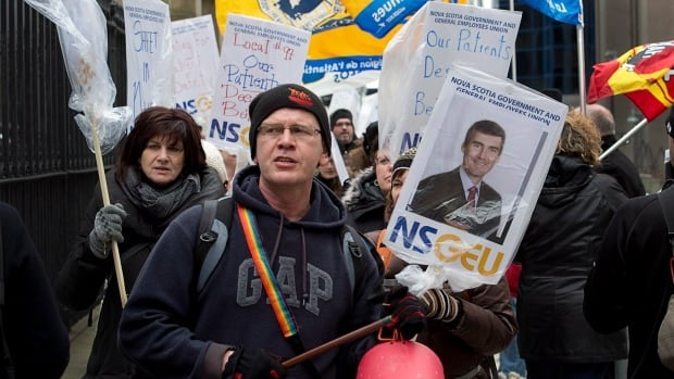 Protesters march outside the legislature in Halifax on Wednesday. Picket lines sprung up outside most Halifax-area hospitals on Thursday as 2,400 unionized nurses went on strike.