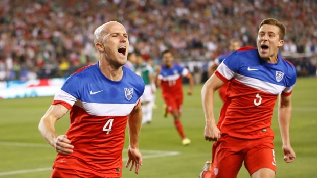 U.S. midfielder Michael Bradley, left, celebrates with defender Matt Besler after scoring a goal against Mexico during the first half in Glendale, Ariz.