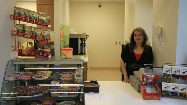 Angela Jaspan standing behind the counter of Colours Cafe.