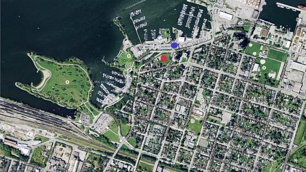 This overhead shot shows the north-end neighbourhood and the waterfront, part of which the city plans to develop in the coming years. The North End Neighbours group is fighting the city at the Ontario Municipal Board, saying it wasn't consulted in the development of a new zoning bylaw dictating future development. The red dot shows the location of Bayview Park, the blue dot the approximate location of future commercial development. (North End Neighbours, Google Maps, CBC Hamilton)