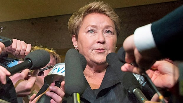 Parti Quebecois Leader Pauline Marois speaks to reporters following a speech to the Montreal Chamber of Commerce on Wednesday. She's now promising tax breaks in two years time, once the budget is balanced.
