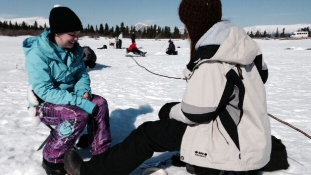 Students learn the art of patience while ice fishing at Fish Lake outside Whitehorse.
