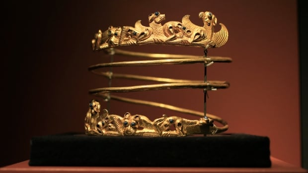 The exhibit Crimea: Gold and Secrets of the Black Sea, on display at Allard Pierson historical museum in Amsterdam, includes ancient artifacts such as bronze swords, golden helmets, precious gems and this spiraling torque dating from the second century A.D.