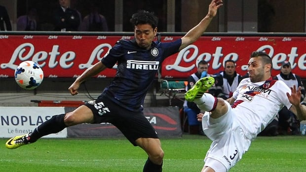 Inter Milan's Yuto Nagatomo, left, competes for the ball with Archimede Morleo of Bologna FC during their Serie A match Saturday in Milan.