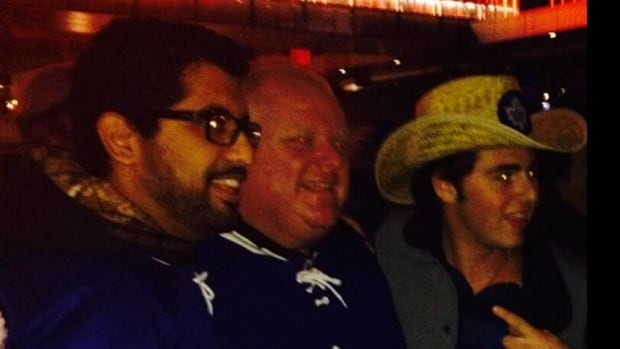 Toronto Mayor Rob Ford poses with hockey fans while attending the Leafs-Jets game at the Air Canada Centre.