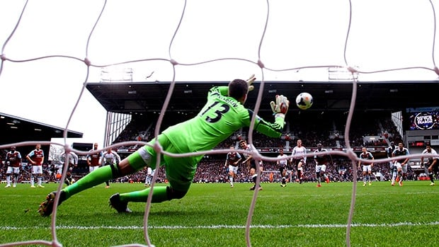 Steven Gerrard of Liverpool scores his team's second goal from the penalty spot past goalkeeper Adrian of West Ham on Sunday in London.