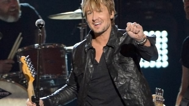 Keith Urban performs onstage during the Academy Of Country Music Awards. The country star will headline the first concert hosted by the Hamilton Tiger-Cats in the new Tim Hortons Field stadium.