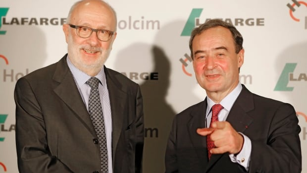 Bruno Lafont, right, chairman and chief executive of French cement maker Lafarge Group shakes hands with Swiss cement maker Holcim chairman Rolf Soiron  on Monday after announcing plans for a merger.