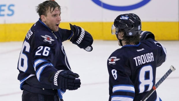 Winnipeg Jets' Blake Wheeler (26) and Jacob Trouba (8) celebrate Wheeler's goal against the Minnesota Wild during the last game between the teams, Dec. 27 in Winnipeg.