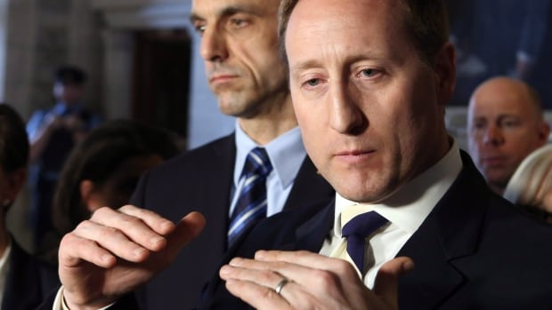 Justice Minister Peter MacKay, right, said he is trying to find 'the right balance' in rewriting Canada's prostitution laws following last year's court decision striking down existing laws. He said Monday he will introduce a new law this spring that will protect victims of the sex trade.