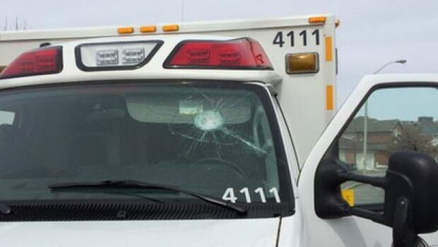 Multiple witnesses said a man struck the ambulance windshield with a golf club.
