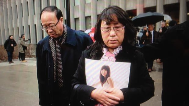 The parents of Qian Liu are seen outside a Toronto court on Monday, after a jury found Brian Dickson guilty of first-degree murder in their daughter's death.