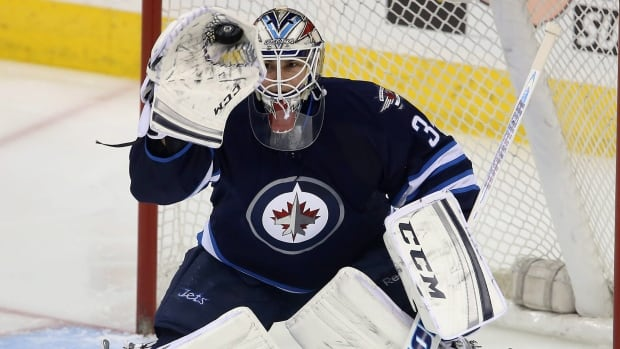 Winnipeg Jets goaltender Michael Hutchinson makes a glove save against the Minnesota Wild in his first NHL start on April 7.