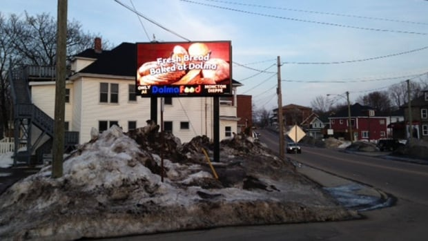 Moncton councillors are press city staff to find a way to remove a controversial electronic billboard that sparked a petition from angry neighbours.
