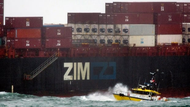 A boat from the Atlantic Pilotage Authority approaches the container ship Zim Shenzhen in Halifax. The IMF says Canadian exports are not as strong as could be expected and also points to risks in commodity prices.