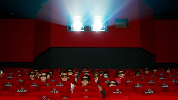 Patrons watch a 3D Imax movie in Beijing in May 2012. Imax has sold 20 per cent of its China unit to two Chinese investors for $80 million US.