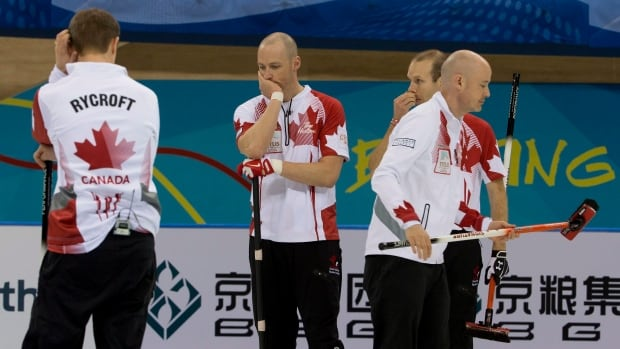 Canadian players, from left, Carter Rycroft, Nolan Thiessen, Pat Simmons and Kevin Koe react during their final match at the world championship on Sunday.