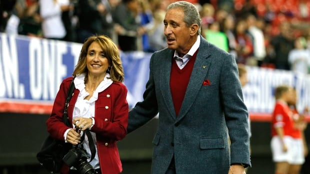 Atlanta Falcons owner Arthur Blank and fiancee Angela Macuga walk the pitch prior to a friendly at Georgia Dome on Feb. 13.