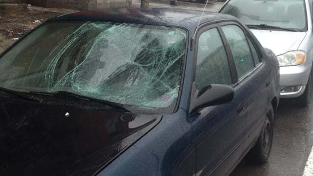 The windshield of a blue Toyota Corolla was smashed in after the car and a cyclist collided on the Plateau-Mont-Royal Tuesday morning.