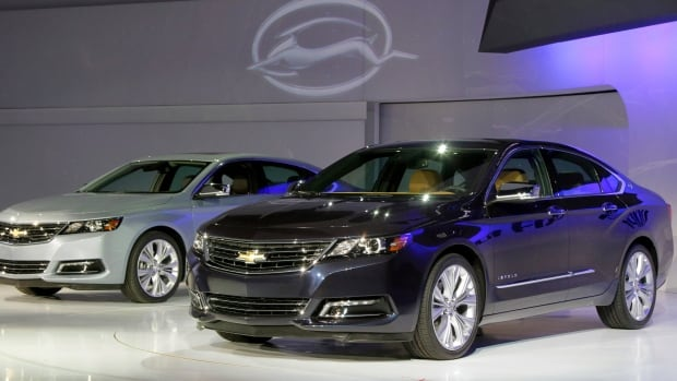 Two 2013 Chevrolet Impalas are shown at the New York International Auto Show. An auto safety group says earlier versions of the Impala have a defect in the way airbags are deployed.