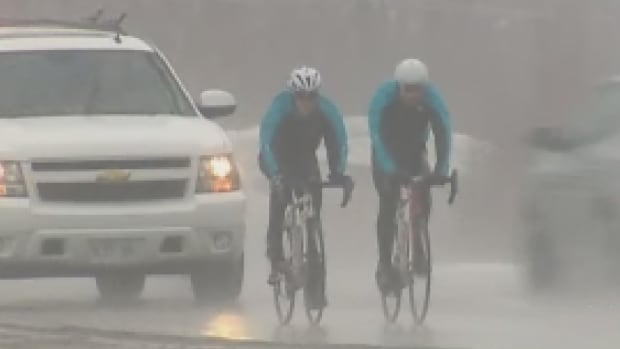 Hughes cycled through pouring rain Tuesday on her way from Woodstock to Fredericton.