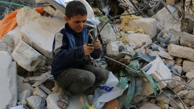 Abed Al-Jalil, 12, collects copper from rubble to sell it to a vendor in the al-Myassar neighbourhood of Aleppo. The UN's high commissioner for human rights said the Syrian government's forces have committed atrocities that 'far outweigh' abuses committed by rebels fighters.