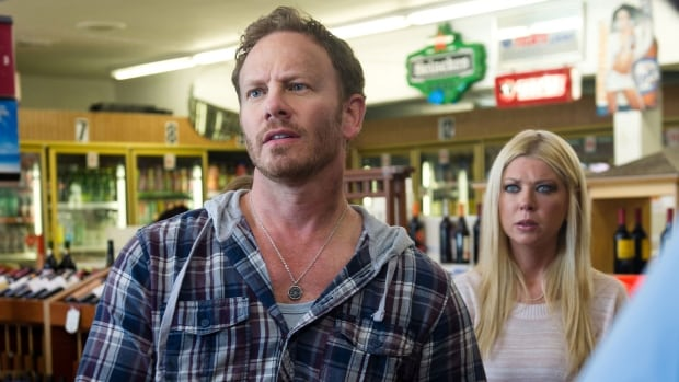 This photo released by Syfy shows Ian Ziering, left, as Fin, Tara Reid as April in a scene from the Syfy original movie, Sharknado. A sequel to the film, Sharknado 2: The Second One, will air this summer.