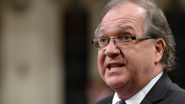 Minister of Aboriginal Affairs Bernard Valcourt's office says the First Nations education act will be put 'on hold' while the AFN sorts its position on the bill following the resignation of Shawn Atleo as national chief.