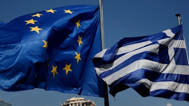 An EU and a Greek flag fly in front of the ancient Parthenon temple, in Athens, on Wednesday. Greece announced Wednesday it was returning to international bond markets for the first time in four years.