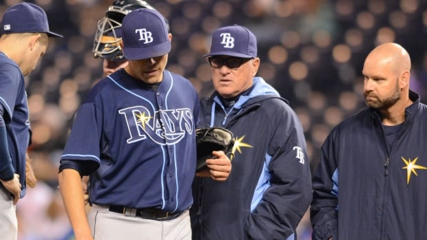 Tampa Bay Rays starting pitcher Matt Moore leaves the field injured during the fifth inning against the Kansas City Royals at Kauffman Stadium. There's still a possibility the young Rays pitcher will require surgery after being placed on the disabled list.