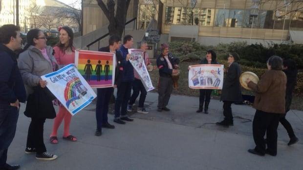 Protesters gathered outside TDSB headquarters Wednesday evening, demonstrating against a controversial proposal about public nudity and the Pride parade.