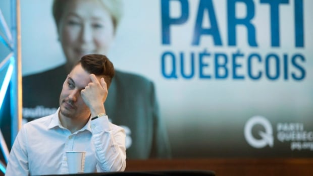 A Parti Québécois supporter watches provincial election results at the party's reception in Montreal on Monday, April 7.
