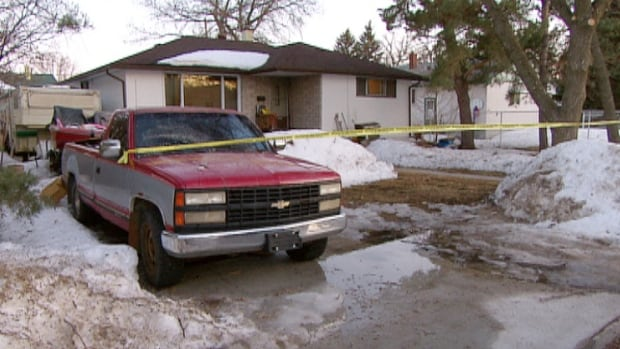 Winnipeg police at a home in the 100 block of Barrington Avenue as part of a homicide investigation.