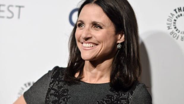 Veep star Julia Louis-Dreyfus appears on this month's Rolling Stone cover nude, with a tattoo of the Constitution incorrectly displaying John Hancock's signature.