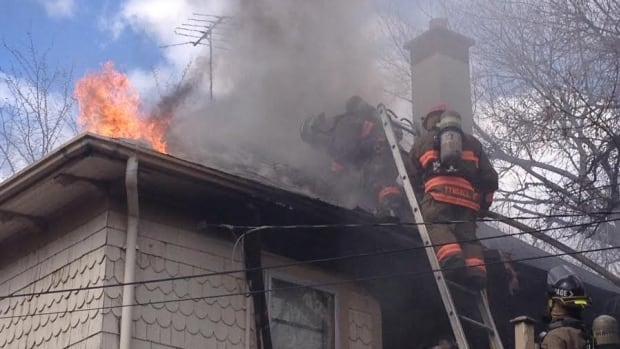 Saskatoon firefighters battle a fire that broke out in a Varsity View home this afternoon.