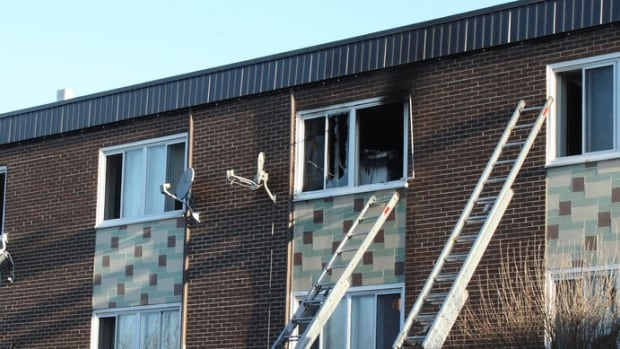 Firefighters used ladders to rescue six people from windows in the apartment building.