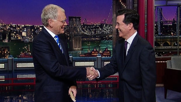 Stephen Colbert is seen here shaking hands with David Letterman on The Late Show on May 4, 2011. Colbert will replace Letterman as The Late Show's host in 2015.