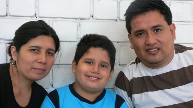 Juan Jose Ariza, pictured here with his wife, Edith, and eight-year-old son, Flavio, was involved in a 2012 crash near Hampstead, Ont., that killed 10 Peruvian migrant workers. Ariza sustained a fractured pelvis and broken ribs. Two years later, his doctor says he has only made a 20 per cent recovery.