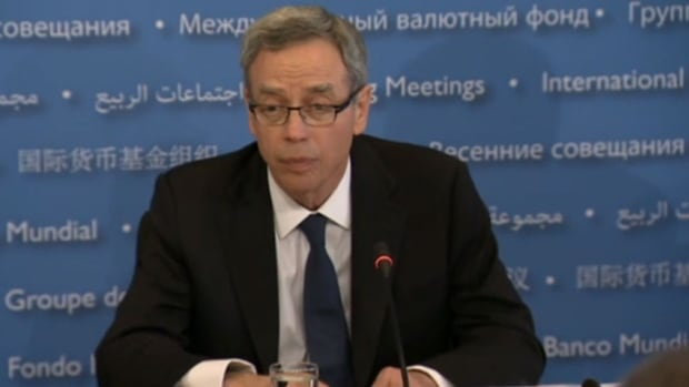 Canadian finance minister Joe Oliver addresses a news conference in Washington after the G20 meeting.