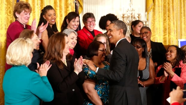 U.S. President Barack Obama greets women after he signed two new executive actions aimed at increasing transparency about women's pay during an event at the White House on April 8, 2014.