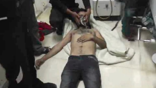 An unverified video shows a man as he lies on the floor with an oxygen mask at a hospital room in Kfar Zeita, some 200 kilometres north of Damascus, Syria.  Samantha Power, the U.S. ambassador to the United Nations, said on Sunday that the UN 'will do everything in our power to establish what has happened and then consider possible steps in response.'