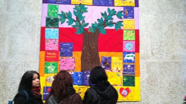 A quilt made by the families of missing and murdered Manitoba women was unveiled Saturday at the Winnipeg Art Gallery. It honours the victims and is meant to help the families heal.