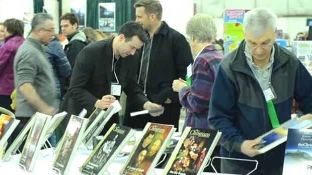 Parents browse through textbooks at the Alberta Home Education Association conference in Red Deer.