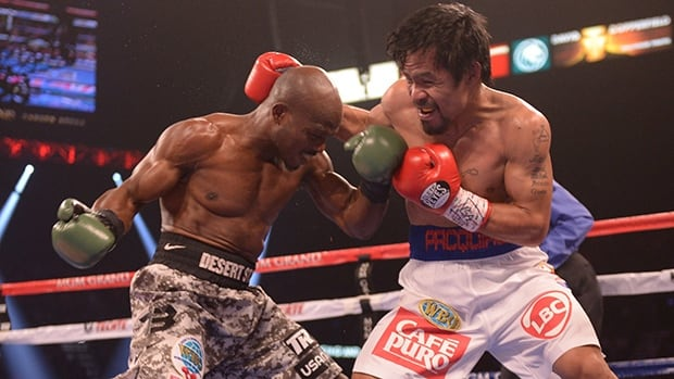 Timothy Bradley, left, exchanges blows with Manny Pacquiao during their WBO World Welterweight Championship title match at the MGM Grand Arena in Las Vegas, Nevada on Saturday.