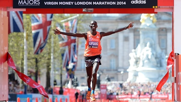 Wilson Kipsang of Kenya exults in winning as he crosses the finish line first in the Virgin Money London Marathon on Sunday.